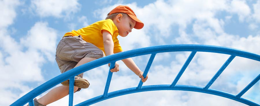little-boy-climbing-frame